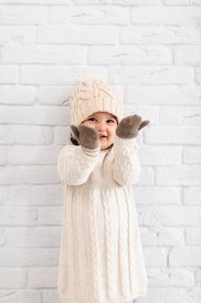 Cute little girl raising her hands
