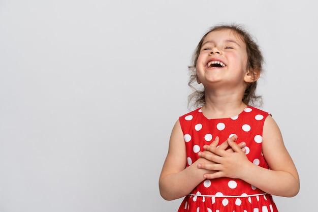 Cute little girl in a red dress