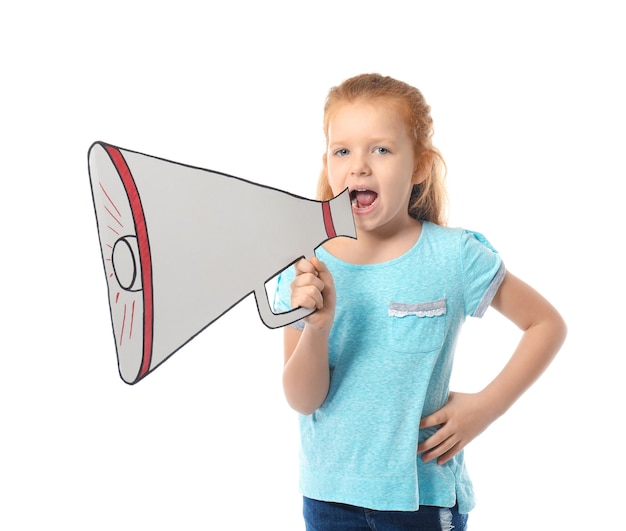 Cute little girl shouting into paper megaphone on white