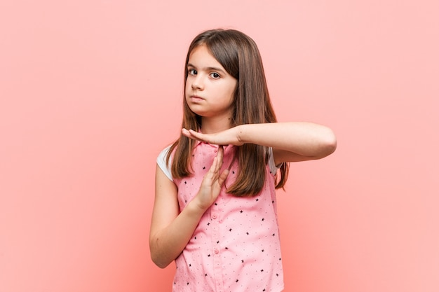 Cute little girl showing a timeout gesture.