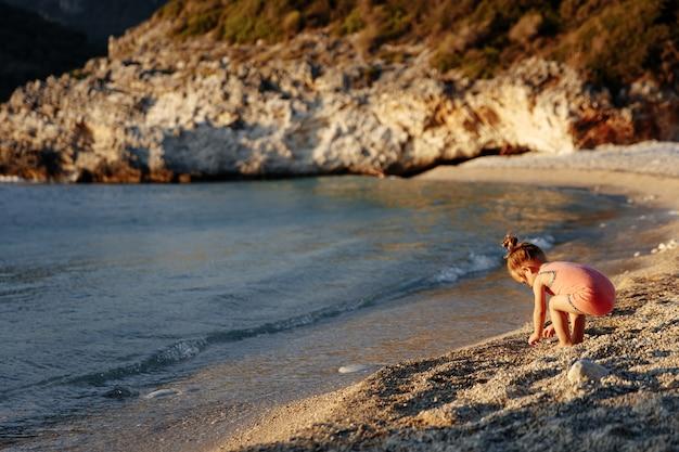 Cute little girl standing near the sea