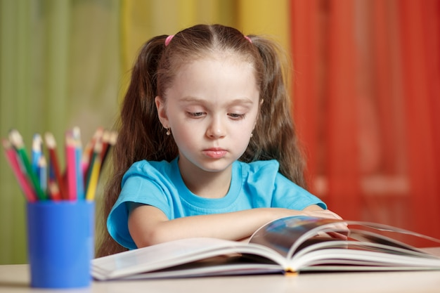 Cute little girl studying at home