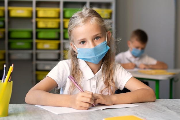 Cute little girl wearing a medical mask