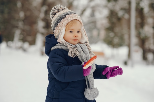 Cute little girl in winter park