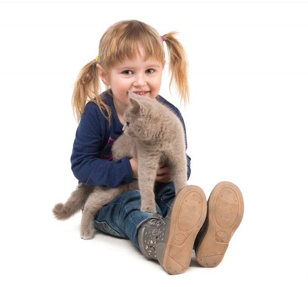 Cute little girl with cat in hands