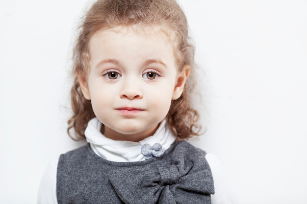 Cute little girl with curly hair. close-up.