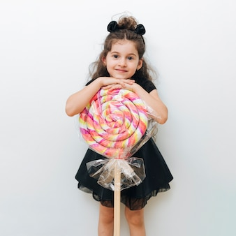 Cute little girl with giant lollipop
