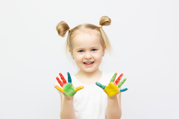 Cute little girl with painted hands. isolated on white background banner copy space