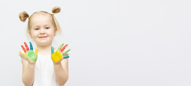 Cute little girl with painted hands. isolated on white background.banner copy space