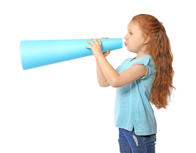 Cute little girl with paper megaphone on white