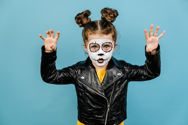 Cute little girl with scary make up for halloween