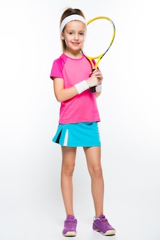 Cute little girl with tennis racket in her hands on white