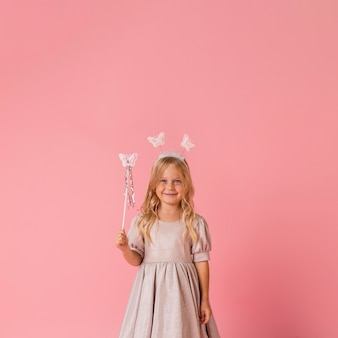 Cute little girl with wand and copy space
