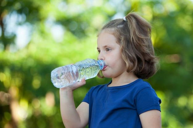 Cute little girl with water bottle