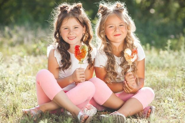 Cute little girlfriends having fun together