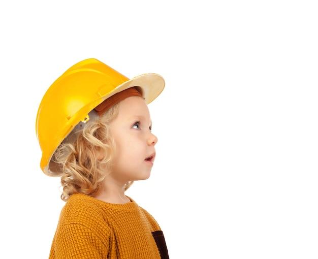 Cute little kid with yellow helmet