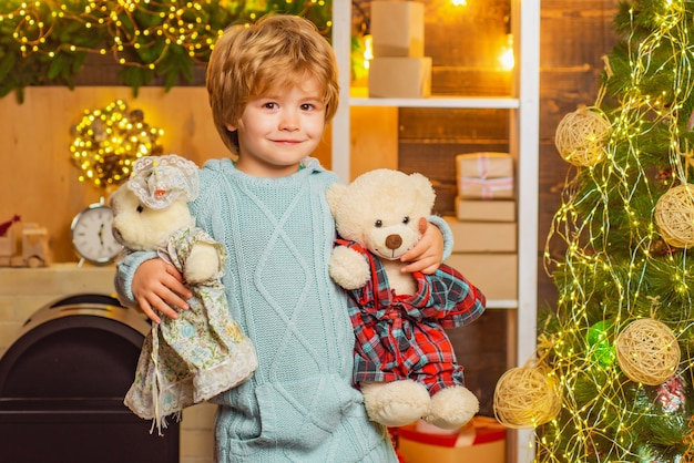 Cute little kids celebrating christmas with teddy bear