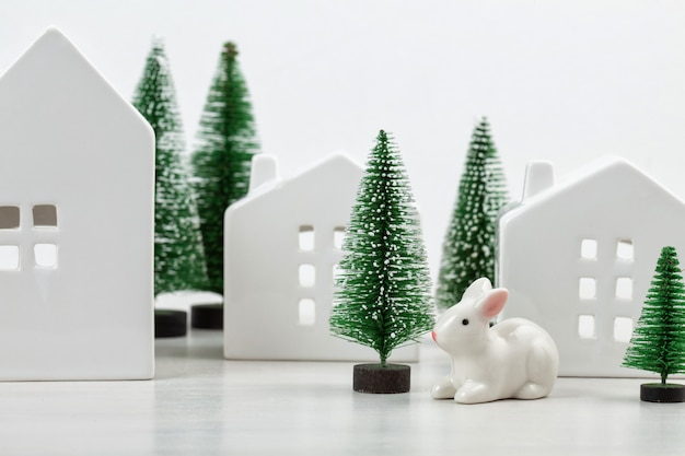 Cute little white houses and christmas decoration with the copy space for text.