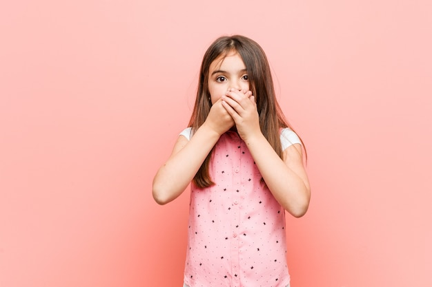 Cute little woman shocked covering mouth with hands