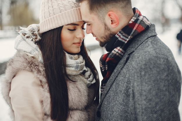 Cute and loving couple in a winter city