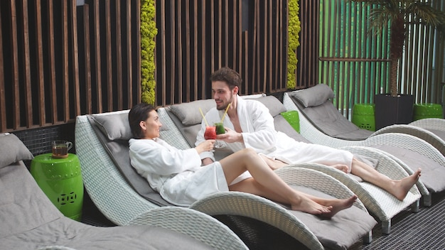 Cute man with a beard is relaxing with his beloved woman in a spa center
