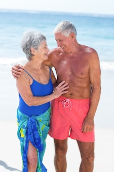 Cute mature couple embracing on the beach