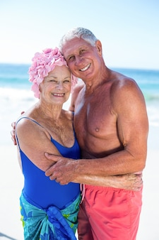 Cute mature couple hugging on the beach