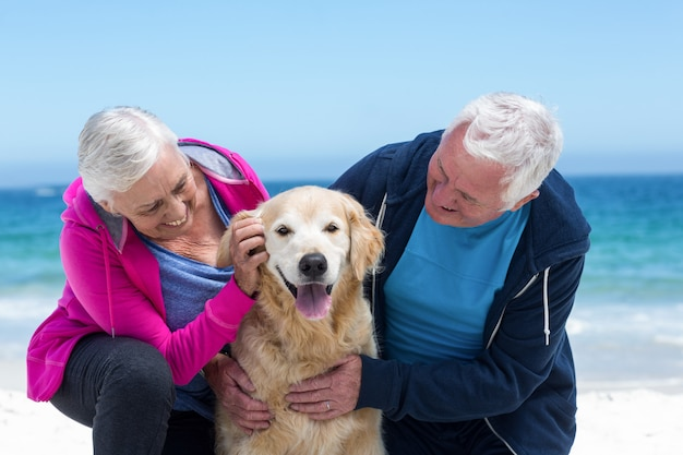 Cute mature couple petting their dog