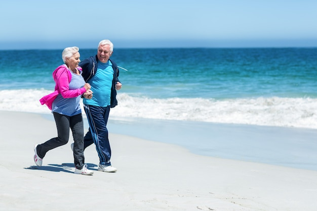 Cute mature couple running together