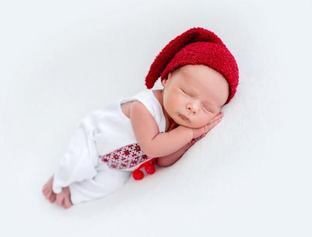 Cute newborn wearing embroidered shirt