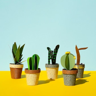 Cute paper cut style of artificial cacti and copy space background