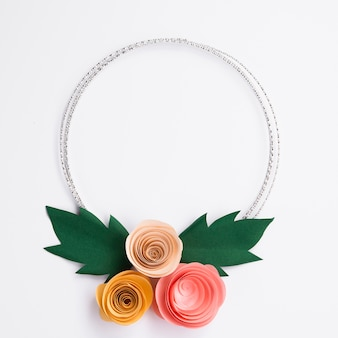 Cute paper flowers frame on white background