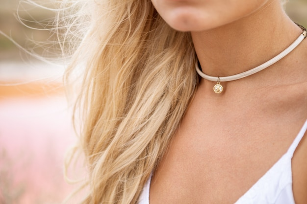 Cute pendant on the girl's neck