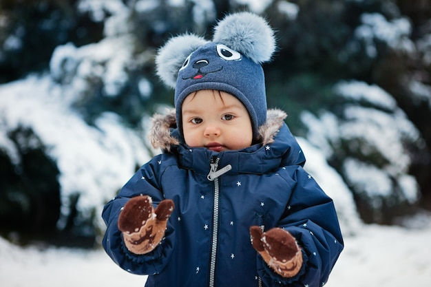 Cute portrait of a toddler boy in the snow