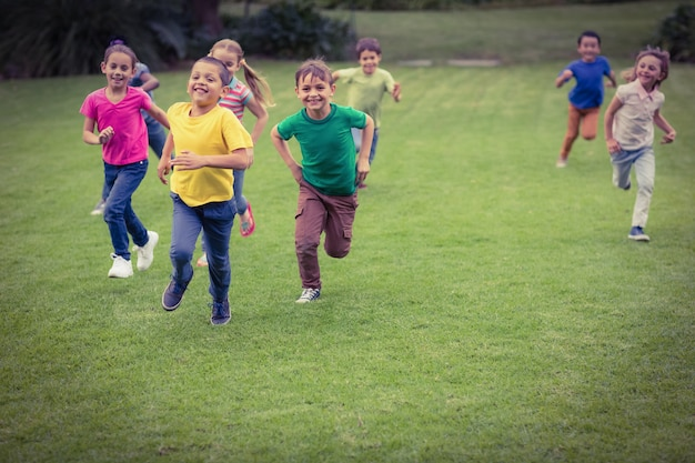 Cute pupils running towards camera