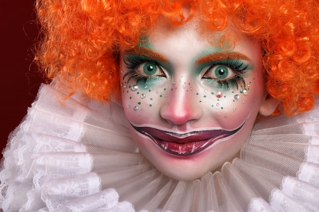 Cute red-haired clown.