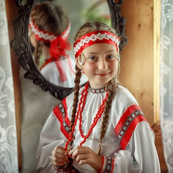 Cute russian girl in a traditional costume