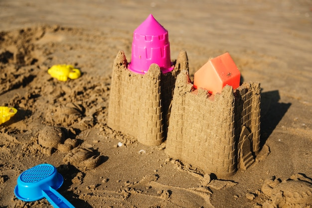 Cute sand castle on the beach