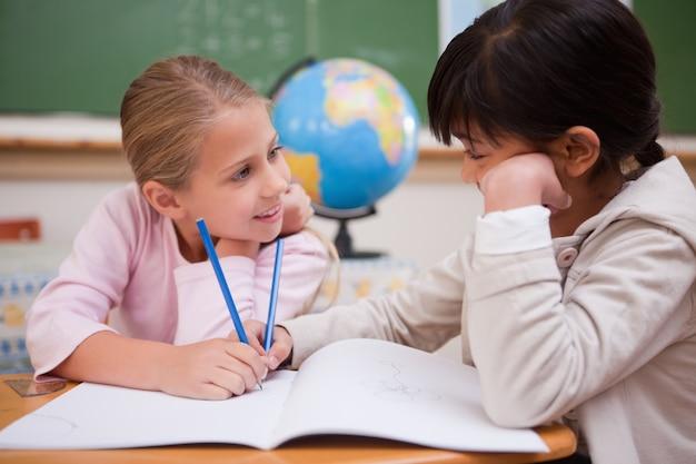 Cute schoolgirls doing classwork