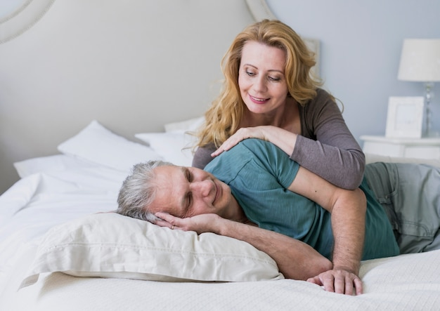 Cute senior couple together in bed