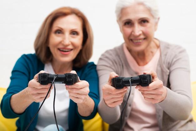 Cute senior women playing video games