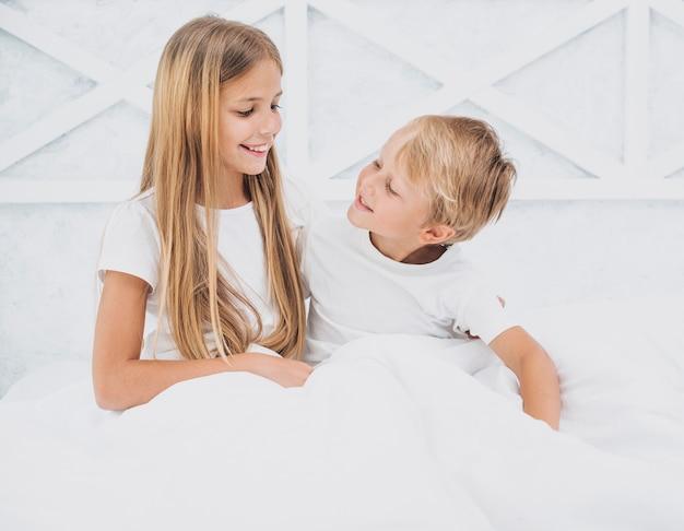 Cute siblings looking at each other