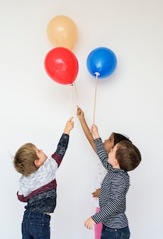 Cute small kids with balloons