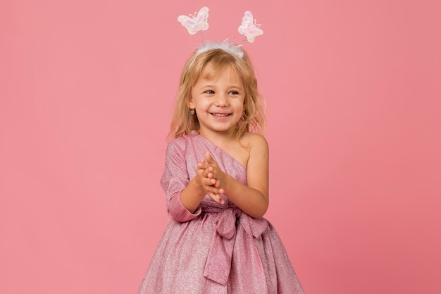 Cute smiley girl with fairy costume