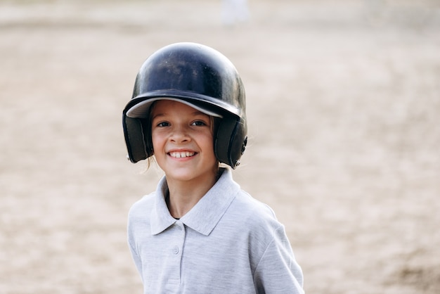 Cute, smiling baseball player looking straight into the camera