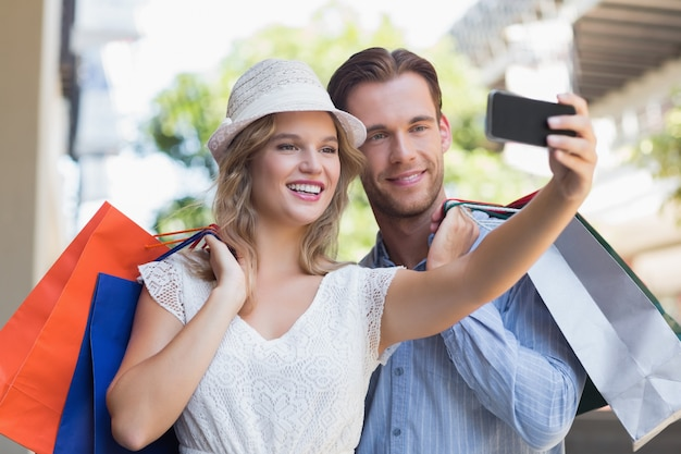 Cute smiling couple taking a selfie