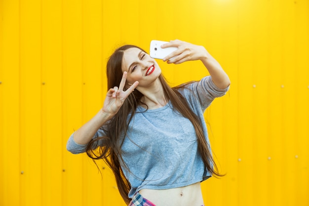Cute smiling girl making selfie