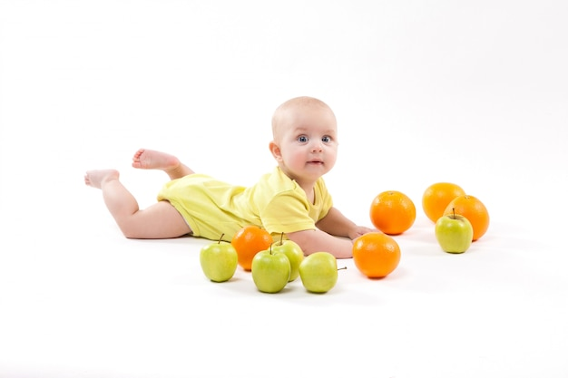 Cute smiling healthy child lies on a white background