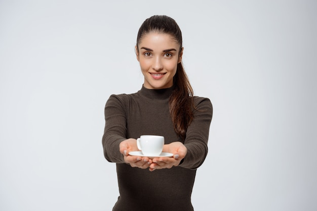 Cute smiling woman give coffee