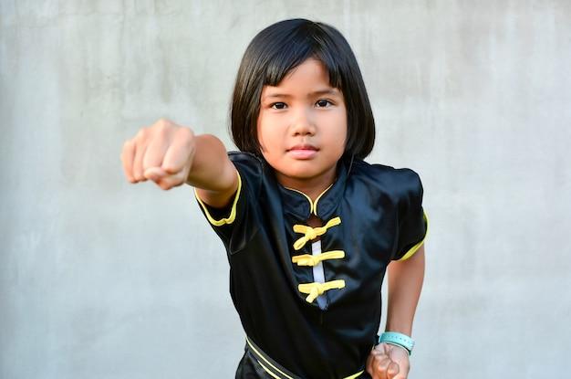 Cute sport girl practicing wushu